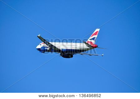SAINT PETERSBURG RUSSIA - MAY 11 2016. G-EUUC British Airways Airbus A320 airplane is flying in the sky after departure.