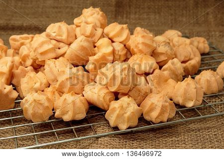 Choux cream in bakery tray on wood table.
