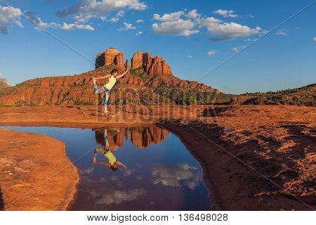woman practicing yoga near cathedral rock sedona arizona
