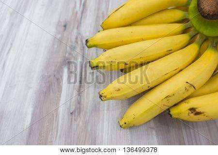 Fresh bananas on wooden table