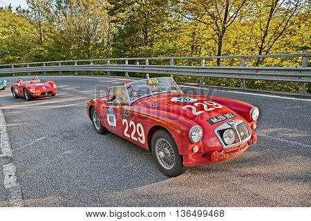 PASSO DELLA FUTA (FI) ITALY - MAY 21: driver and co-driver on a vintage competition car MG A