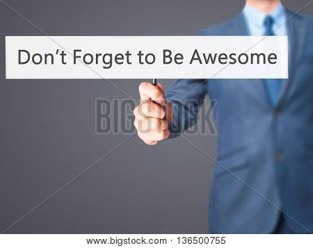 Don't Forget To Be Awesome - Businessman Hand Holding Sign