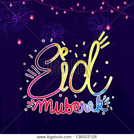Colourful Text Eid Mubarak with glowing lights decoration on fireworks and mosque silhouetted purple background, Elegant Greeting Card design for Muslim Community Festival celebration.