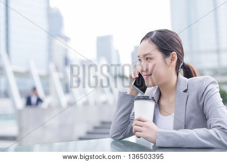 business woman smile speak smart phone and hold coffee cup in office asian beauty