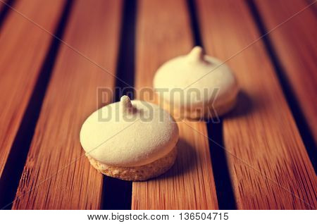 Biscuits with meringue with coffee aroma. Selective focus.