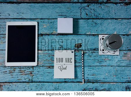 an image of a tablet look down on a table and a few other items