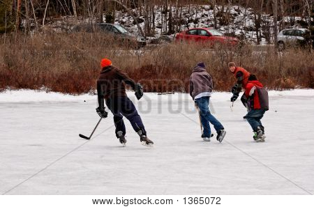 Boys  Playing Hockey Outdoors