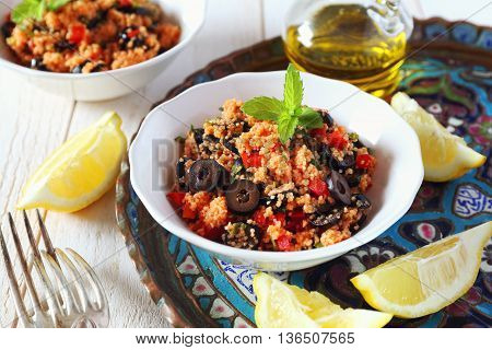 Tabbouleh salad with tomato sauce olives and red pepper