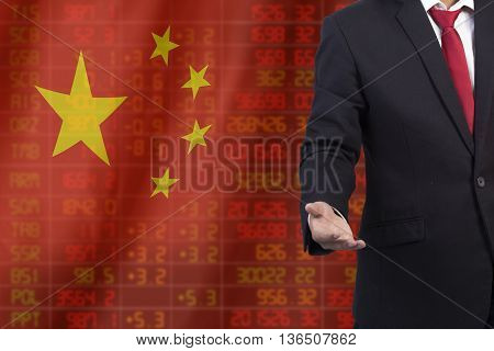 Flag Of China. Downtrend Stock Data Diagram With Business Man With Empty Hand