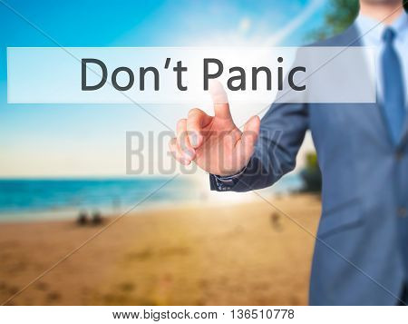 Don't Panic - Businessman Hand Pressing Button On Touch Screen Interface.