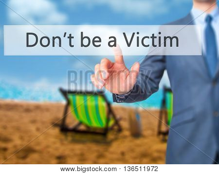 Don't Be A Victim - Businessman Hand Pressing Button On Touch Screen Interface.
