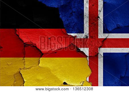 Flags Of Germany And Iceland Painted On Cracked Wall