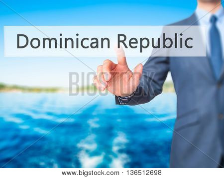 Dominican Republic - Businessman Hand Pressing Button On Touch Screen Interface.