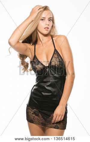 Sexy attractive blonde woman posing in fashionable lingerie in studio