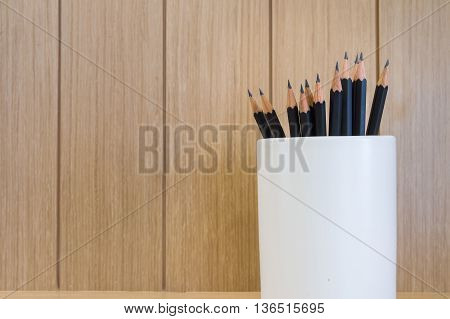 Pencil with box Wood brown texture background.