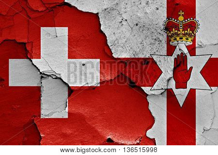 Flags Of Switzerland And Northern Ireland Painted On Cracked Wall