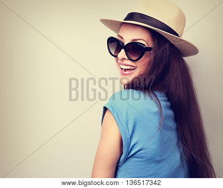 Happy Casual Toothy Laughing Woman In Summer Hat And Sunglasses. Toned Closeup Portrait