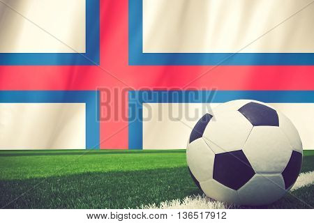 Soccer Ball And National Flag Of Faroe Islands Lies On The Green Grass Vintage Color