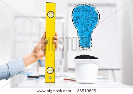 Hand of business person measuring with ruler idea for income growth