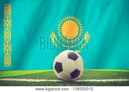 Soccer Ball And National Flag Of Kazakhstan Lies On The Green Grass Vintage Color
