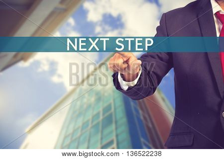Businessman Hand Touching Text Step Tab On Virtual Screen Vintage Color