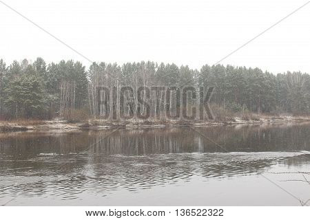Kan River and the the taiga in cloudy weather