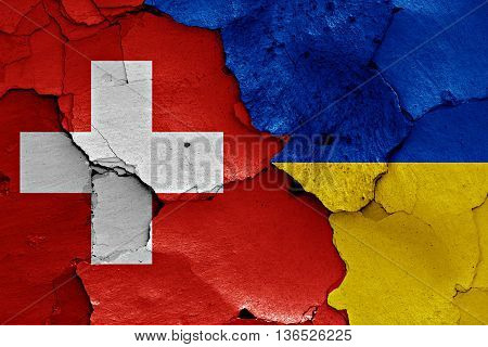 Flags Of Switzerland And Ukraine Painted On Cracked Wall