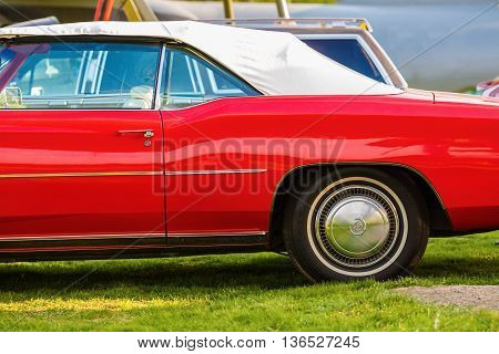 MINSK BELARUS - MAY 07 2016: Red Cadillac Eldorado 1976 model year. Close-up of old vintage red car.