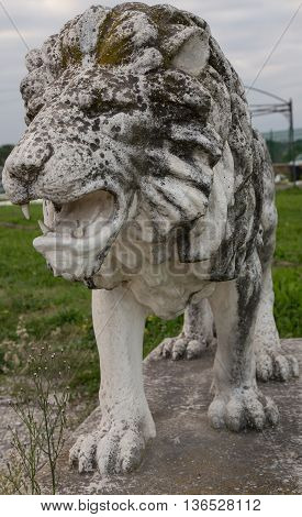 Statue of Lion partially ruined by the time