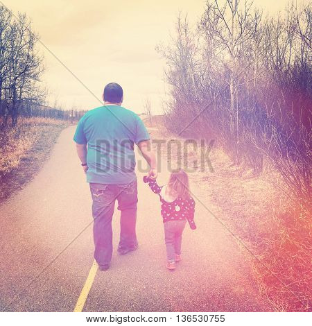 Father and daughter walking together - Instagram effect