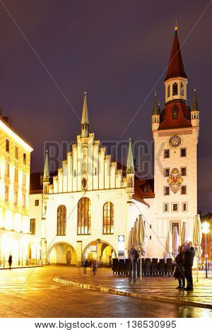 Old Town hall at Marienplatz in Munich at night, Germany. Retro style filtered image