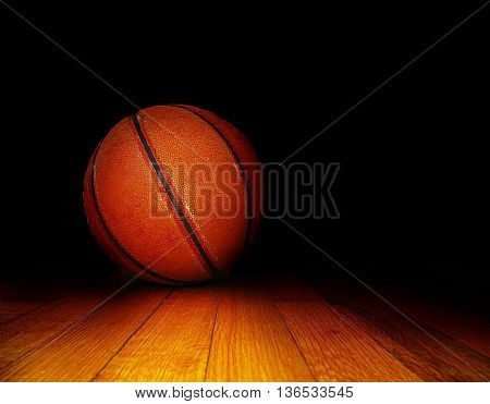 basketball on the court over dark background