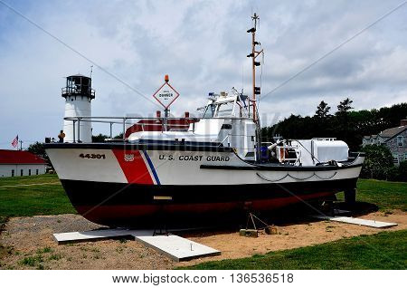 Chatham Massachusetts - July 15 2015: U. S. Coast Guard Cutter #44301 and Chatham Lighthouse