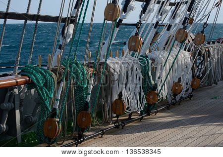 Rigging of a sailing ship, green and white ropes, blocks