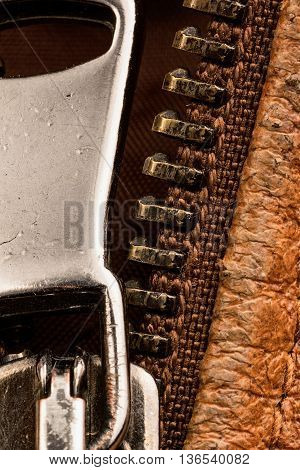 picture of detail of a brown zipper