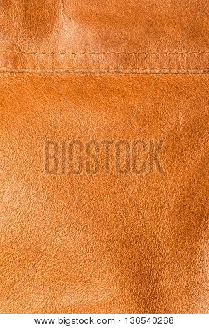 texture of orange - brown hide with seam