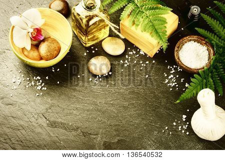 Spa setting with soap bar herbal massage ball and essential oil. Wellness concept