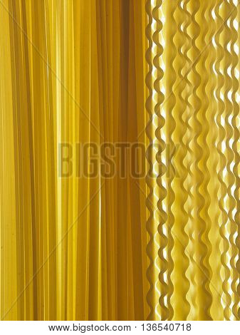 malfaldine and fettuccine dry pasta as background