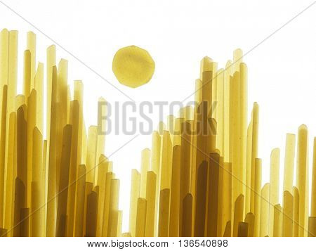 Yellow long spaghetti on black background. Thin pasta arranged in rows,different layer and thickness, looks like high rise buildings city scape in the sunset
