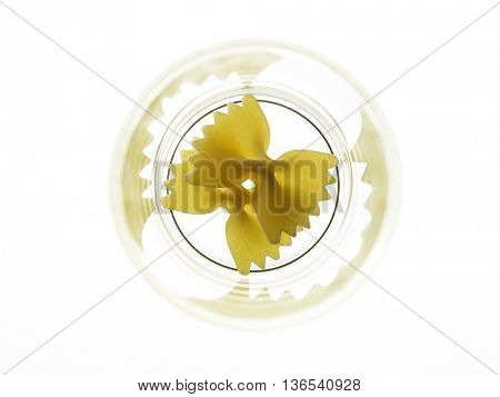 farfalle pasta in a glass bow  on the white background