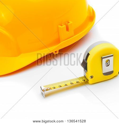 Construction Helmet With Measure Tape On White