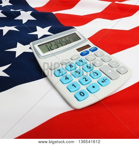 Ruffled National Flag With Calculator Over It - United States