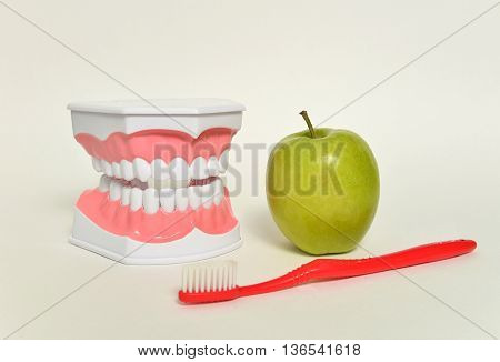 toothbrush and green apple, dental care concept.