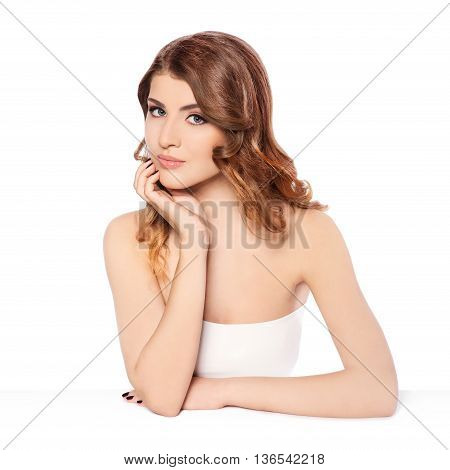 Beautiful young woman looking at camera on white
