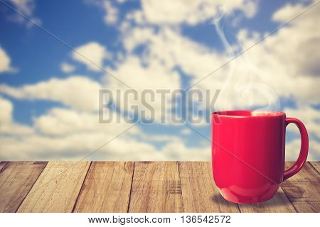 Morning Coffee Cup With Beautiful Blue Sky And Puffy Clouds Background.vintage Color