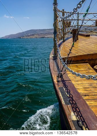 View of the Sea of Galilee from the deck of wooden boat in Tiberias, Israel