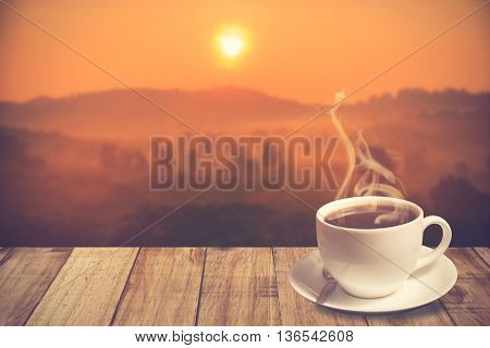 Cup Of Coffee With Mountain At Morning Sunrise.vintage Color