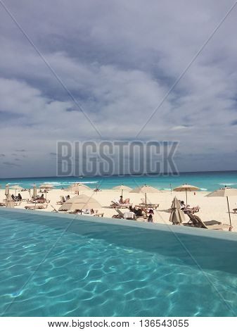 CANCUN, MEXICO - January, 2016. A winter escape to warm tropical weather in Cancun Mexico. This photo was taken from the Westin Lagunamar infinity pool, an oceanfront property owned by Starwood Hotels.