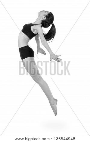 colorless full length portrait of young modern ballet dancer jumping, isolated over white background