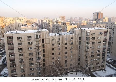 Bucharest, ROMANIA - January 22, 2016: Panoramic view of the business building Phoenix Tower and other residential buildings at sunrise in the area near Unirii Square. BUCHAREST -January 22, 2016